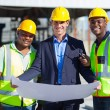 Architect team on construction site — Stock Photo