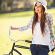Young woman with bicycle — Foto de Stock