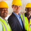 Professional construction manager and workers — Stock Photo
