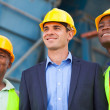 Heavy industry manager and workers — Stock Photo