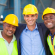 Happy heavy industry manager and workers — Stock Photo