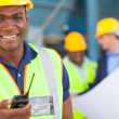 African american industrial worker with walkie talkie — Stock Photo