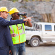 Mine manager showing foreman mining site — Stock Photo