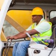 Africa american man operates excavator — Stock Photo