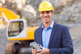 Manager in mining site holding ore — Stock Photo