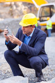 Mine manager inspecting ore — Stock Photo