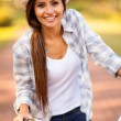 Young woman riding a bicycle outdoors — Stock Photo #26389723
