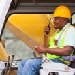 Stock Photo: African industrial worker operating bulldozer