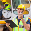 Construction foreman talking on walkie-talkie — Stock Photo