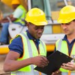 Construction co-workers discussing about work plan — Stock Photo
