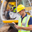 Construction manager writing report — Stockfoto