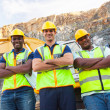 Quarry workers standing with arms crossed — Stock Photo