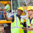 Co-workers talking at construction site — Stock Photo