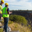 Surveyors working at mining site — Stock Photo