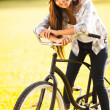 Stock Photo: Young woman posing on a bike