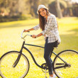 Young woman riding a bicycle outdoors — Stock Photo