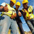 Construction workers giving thumbs up — Stock Photo
