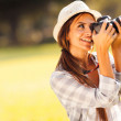 Young female photographer taking pictures — Stock Photo