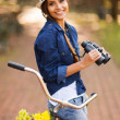 Happy woman with binoculars outdoors — Stock Photo