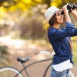 Young woman bird watching at the park — Stock Photo