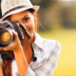 Foto Stock: Attractive young womtaking pictures