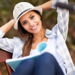 Pretty college student reading book at the park — Stock Photo