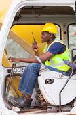 Afro american man operates excavator — Stock Photo