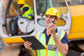 Construction foreman talking on walkie-talkie — Stock Photo