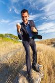Cheerful businessman outdoors — Stock Photo