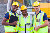 Smiling construction workers — Stock Photo