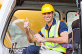 Earthmover operator giving thumb up — Stock Photo