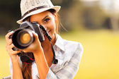 Attractive young woman taking pictures — Stok fotoğraf