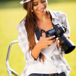 Beautiful woman reviewing photos on camera — Stok fotoğraf