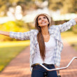 Young woman enjoying riding bike — Stock Photo #26390351