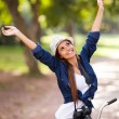 Carefree young woman arms open outdoors — Stock Photo #26390485