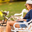 Young woman at the park using laptop — Stock Photo