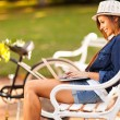 Young woman at the park using laptop — Stock Photo #26390669