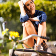 Young woman relaxing outdoors — Stock Photo #26390939