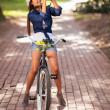 Attractive young woman taking pictures on her bike — Stock Photo #26391245