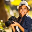 Stock Photo: Beautiful female student photographer with camera