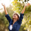 Young womoutdoors with arms outstretched — Stok Fotoğraf #26392559