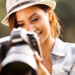 Stock Photo: Pretty womreviewing photos on camera