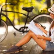 Young woman studying at the park — Stok fotoğraf
