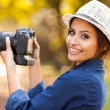 Young woman learning to use camera — Stock Photo