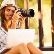 Female photographer taking pictures at the park — Stock Photo