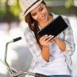 Young woman using tablet computer outdoors — Stock Photo