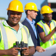 African construction worker holding binoculars — Stock Photo