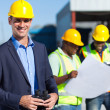 Construction supervisor with binoculars — Stock Photo