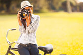 Young woman taking photo outdoors — Stock Photo