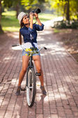 Attractive young woman taking pictures on her bike — Stock Photo